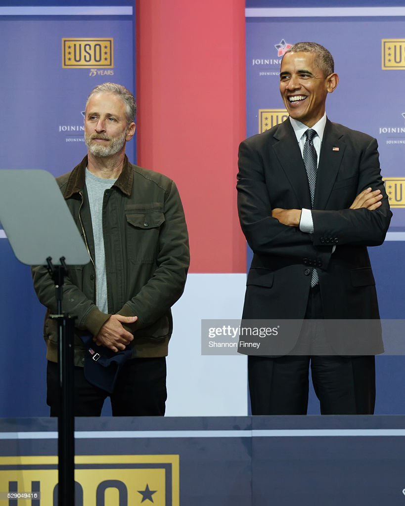 Master of Ceremonies Jon Stewart and the President at the 75th Anniversary USO Show on May 5 2016 at Joint Base Andrews in Camp Springs Maryland
