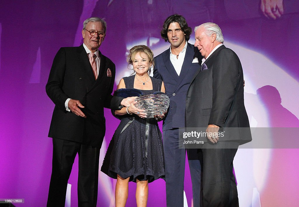 Master of Ceremonies <a gi-track='captionPersonalityLinkClicked' href=/galleries/search?phrase=Tom+Brokaw&family=editorial&specificpeople=203263 ng-click='$event.stopPropagation()'>Tom Brokaw</a> (L) and <a gi-track='captionPersonalityLinkClicked' href=/galleries/search?phrase=Nacho+Figueras&family=editorial&specificpeople=2308997 ng-click='$event.stopPropagation()'>Nacho Figueras</a> (second from right) present The Buoniconti Fund Award to Swanee DiMare and Paul DiMare onstage at Destination Fashion 2012 To Benefit The Buoniconti Fund To Cure Paralysis, the fundraising arm of The Miami Project to Cure Paralysis, on November 10, 2012 at Bal Harbour Shops in Miami, Florida.