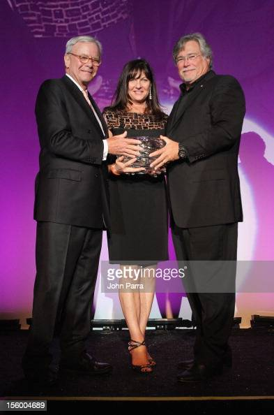 Master of Ceremonies Tom Brokaw presents the Inspiration Award to Madeleine Arison and Micky Arison at Destination Fashion 2012 To Benefit The...