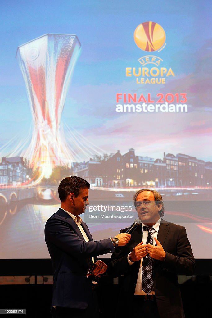 Master of Ceremony, Wilfred Genee (L) and <a gi-track='captionPersonalityLinkClicked' href=/galleries/search?phrase=Michel+Platini&family=editorial&specificpeople=206862 ng-click='$event.stopPropagation()'>Michel Platini</a>, President of the Union of European Football Associations speak to the media and guests during the UEFA Europa League trophy handover ceremony at Beurs van Berlage on April 18, 2013 in Amsterdam, Netherlands. Amsterdam Arena will host the final of the UEFA Europa League on May 15.