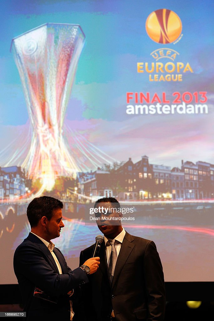 Master of Ceremony, Wilfred Genee (L) and <a gi-track='captionPersonalityLinkClicked' href=/galleries/search?phrase=Patrick+Kluivert&family=editorial&specificpeople=167278 ng-click='$event.stopPropagation()'>Patrick Kluivert</a>, former player and UEFA Europa League Final 2013 Ambassador speak to the media and guests during the UEFA Europa League trophy handover ceremony at Beurs van Berlage on April 18, 2013 in Amsterdam, Netherlands. Amsterdam Arena will host the final of the UEFA Europa League on May 15.