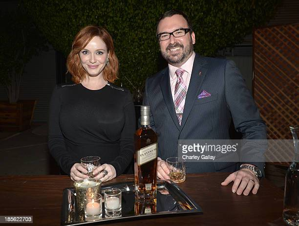 Master of Whisky Stephen Wilson joins Christina Hendricks toast Johnnie Walker Platinum Label at Santa Monica Museum of Art on October 22 2013 in...