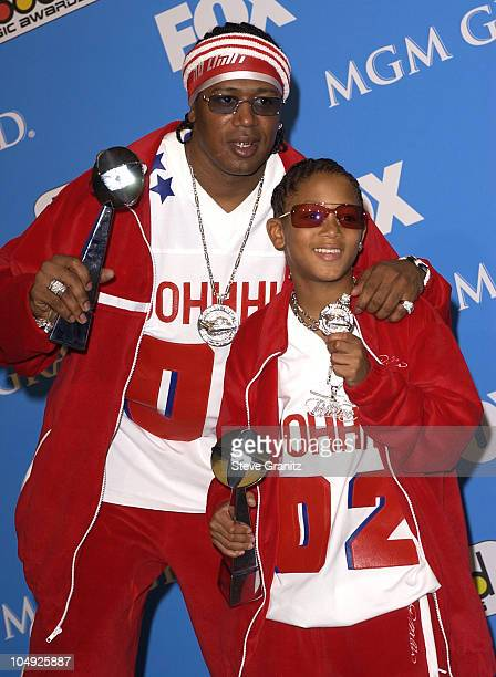 Master P and Lil' Romeo pose backstage with his award for Rap Artist of the Year at the 2001 Billboard Music Awards at the MGM Grand Hotel in Las...