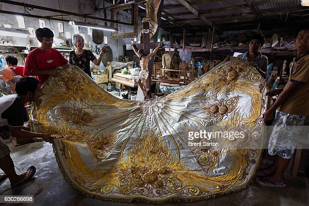 Master seamstress Nene Bernale displays a large cloak embroidered for a large Catholic religious icon in the workshop in Valenzulea close to Manila...