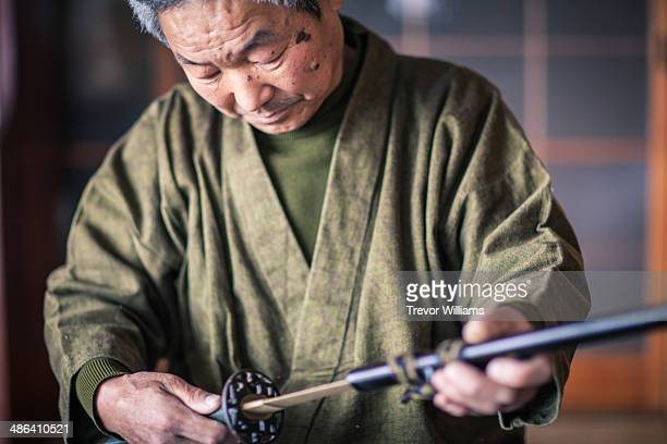 A master sharpener of traditional Japanese swords