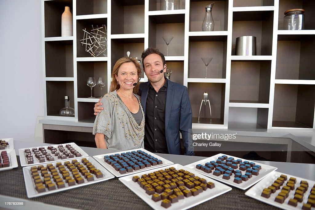 Master sommelier Andrea Robinson (L) and chocolatier Jonathan Grahm speak during day 4 of Moments of Inspiration presented by Infiniti in partnership with Hearst Magazines on August 18, 2013 in Pebble Beach, California.