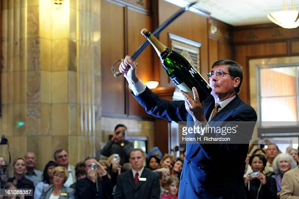 Master swordsman and saberer Bernard Ganter prepares to sever the top off of the large bottle of Moet Chandon champagne The Brown Palace Hotel and...