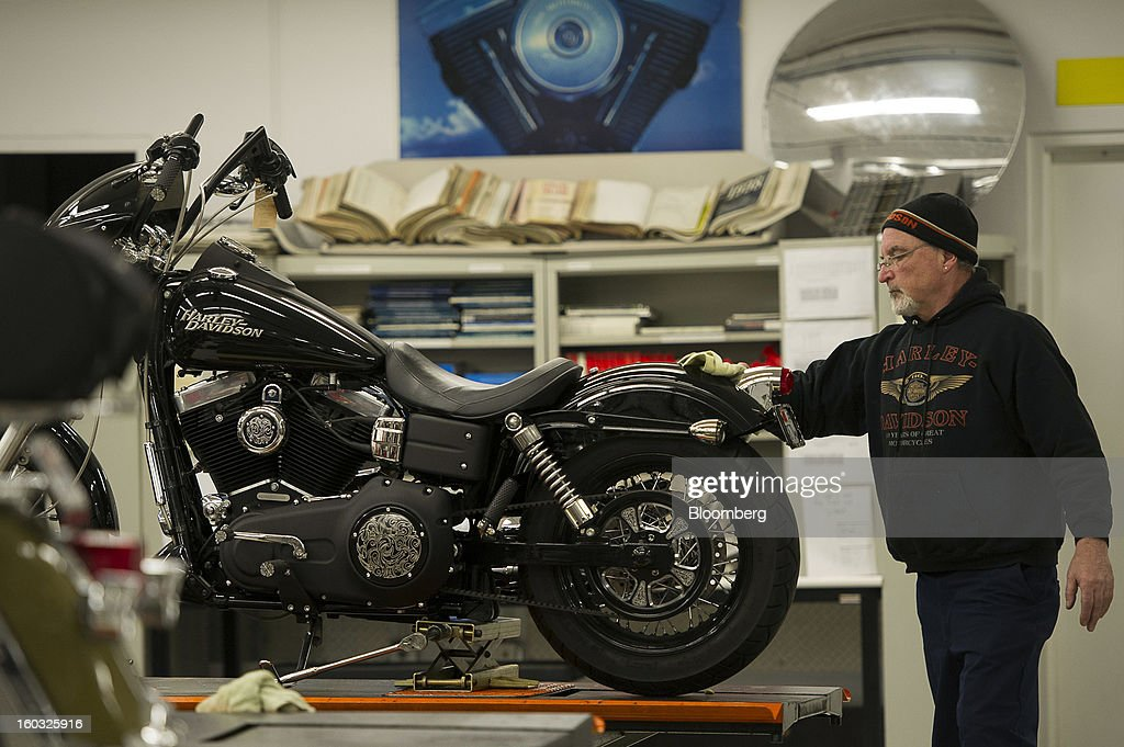 Master Technician Chuck Rockel finishes a repair on a Harley-Davidson Inc. motorcycle at the Dudley Perkins Co. dealership in South San Francisco, California, U.S., on Monday, Jan. 28, 2013. Harley-Davidson reported fourth quarter revenue of $1.17 billion. Photographer: David Paul Morris/Bloomberg via Getty Images