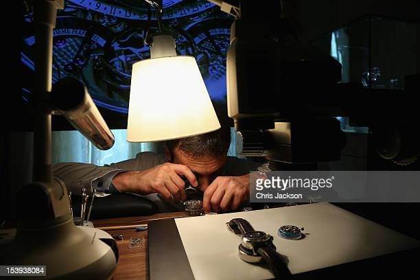 Master Watch Maker Gregory Vandel works on the movements in the Jaeger LeCoultre suite at the Emirates Palace Hotel at Abu Dhabi Film Festival 2012...