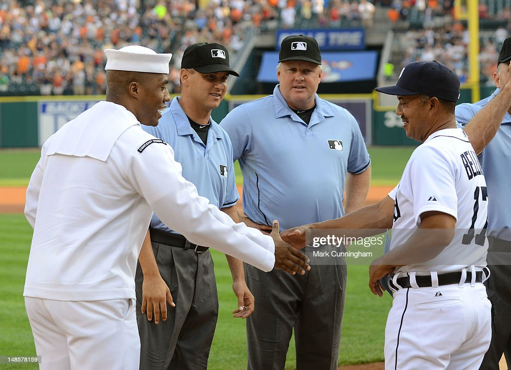 Master-At-Arms First Class Petty Officer Robert Campbell of the United States Navy shakes hands with Rafael Belliard #17 of the Detroit Tigers during a pre-game ceremony before the game against the Kansas City Royals at Comerica Park on July 6, 2012 in Detroit, Michigan. The Tigers defeated the Royals 4-2.