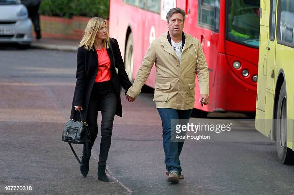 MasterChef Judge John Torode is pictured walking hand in hand with actress girlfriend Lisa Faulkner on March 24 2015 in London England