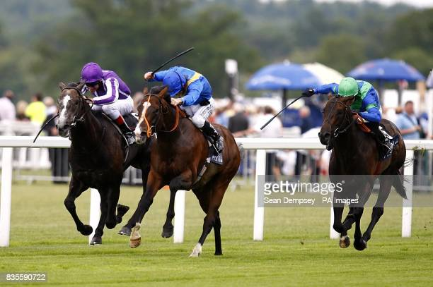 Mastercraftsman ridden by Johnnie Murtagh goes on to win the St James' Palace Stakes ahead of Delegator ridden by Jimmy Fortune and Lord Shanakill...
