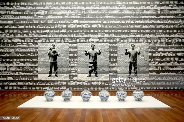 A masterpiece is seen as people visit the 'Ai Weiwei on Porcelain' exhibition after the a press conference that held by Ai Weiwei the most famous...