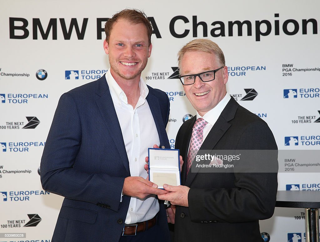 Masters Champion <a gi-track='captionPersonalityLinkClicked' href=/galleries/search?phrase=Danny+Willett&family=editorial&specificpeople=4488861 ng-click='$event.stopPropagation()'>Danny Willett</a> of England receives European Tour Honorary Life Membership from The European Tour Chief Executive <a gi-track='captionPersonalityLinkClicked' href=/galleries/search?phrase=Keith+Pelley&family=editorial&specificpeople=8533833 ng-click='$event.stopPropagation()'>Keith Pelley</a> during the BMW PGA Championship Reception prior to the BMW PGA Championship at Wentworth on May 24, 2016 in Virginia Water, England.