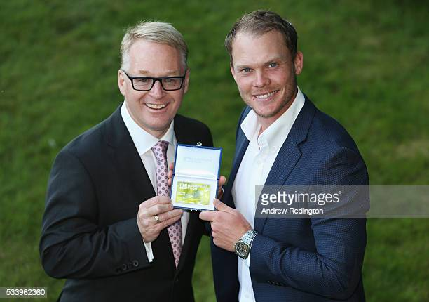 Masters Champion Danny Willett of England receives European Tour Honorary Life Membership from The European Tour Chief Executive Keith Pelley during...