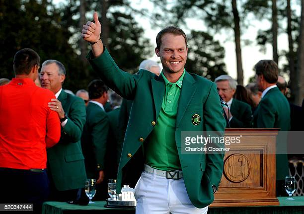 Masters champion Danny Willett smiles and gives the thumbs up after receiving his green jacket from 2015 champion Jordan Spieth on Sunday April 10 at...