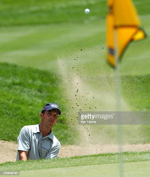Masters champion Mike Weir hits out of the sand trap on the 17th hole of the 2003 International at Castle Pines Colorado Weir finished the day with 9...