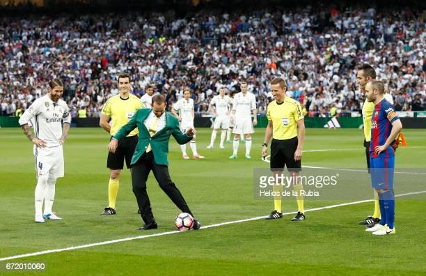 Masters champion Sergio Garcia performs a honorary kick off alongside Sergio Ramos of Real Madrid prior to the La Liga match between Real Madrid CF...
