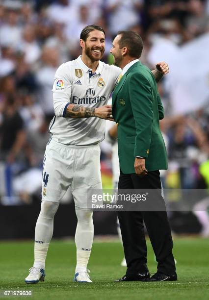 Masters champion Sergio Garcia shakes with Sergio Ramos of Real Madrid as he performs the honorary kick off alongside prior to the La Liga match...