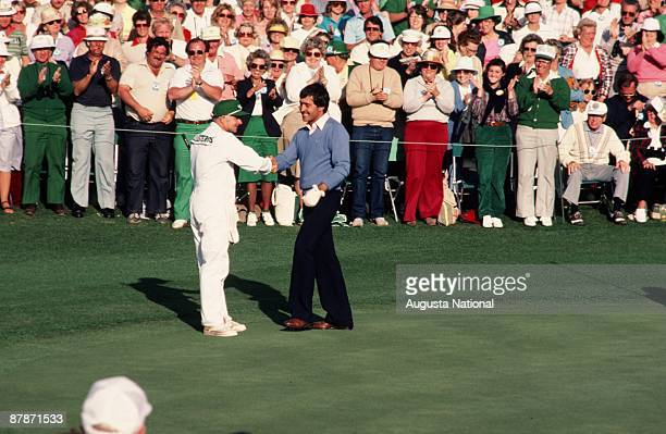 Masters Champion Seve Ballesteros shakes his caddies hand in front of a large gallery during the 1983 Masters Tournament at Augusta National Golf...