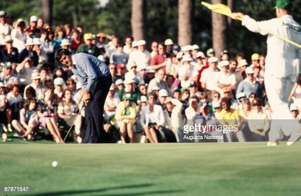 Masters Champion Seve Ballesteros watches his putt in front of a large gallery during the 1983 Masters Tournament at Augusta National Golf Club in...