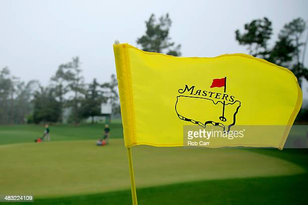 Masters flag blow in the wind during a practice round prior to the start of the 2014 Masters Tournament at Augusta National Golf Club on April 7 2014...