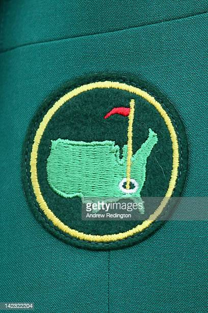 Masters logo is seen on a patch worn on a green jacket by a member of Augusta National Golf Club during a practice round prior to the start of the...