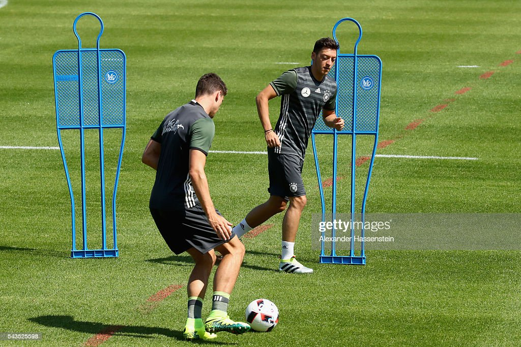 Masut Oezil (R) of Germany plays the ball with his team mate <a gi-track='captionPersonalityLinkClicked' href=/galleries/search?phrase=Mario+Gomez+-+Soccer+Player&family=editorial&specificpeople=635161 ng-click='$event.stopPropagation()'>Mario Gomez</a> during a Germany training session at Ermitage Evian on June 29, 2016 in Evian-les-Bains, France.