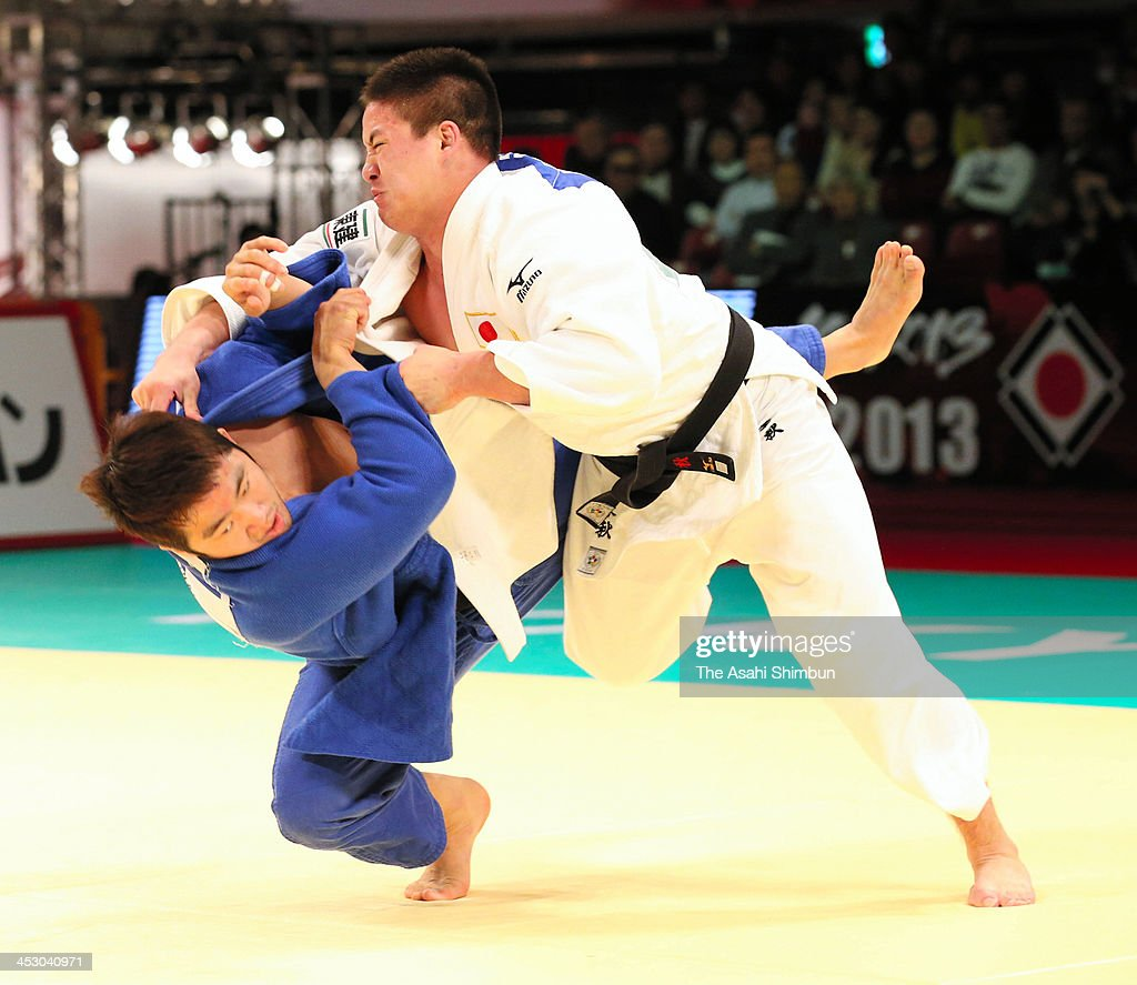 Masyu Beiker (white) of Japan and Kyu-Won Lee of Korea compete in the men's -90kg final match during day three of the Judo Grand Slam at the on December 1, 2013 in Tokyo, Japan.