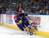 Mat Clark of the Norfolk Admirals checks John Persson of the Bridgeport Sound Tigers during an American Hockey League game on February 2 2013 at the...
