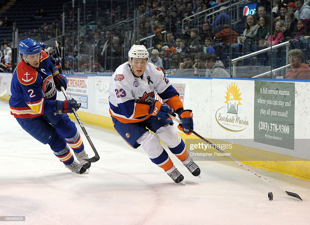 Mat Clark of the Norfolk Admirals skates after John Persson of the Bridgeport Sound Tigers during an American Hockey League game on February 2 2013...