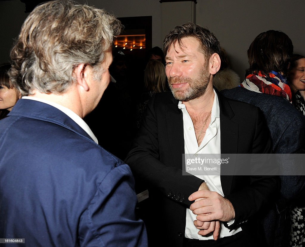 Mat Collishaw (R) attends a private dinner hosted by Lucy Yeomans celebrating Jason Brooks at Cafe Royal on February 12, 2013 in London, England.
