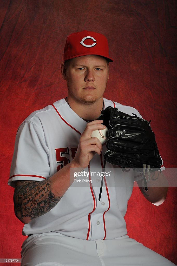 Mat Latos #55 of the Cincinnati Reds poses during MLB photo day on February 16, 2013 at the Goodyear Ballpark in Goodyear, Arizona.