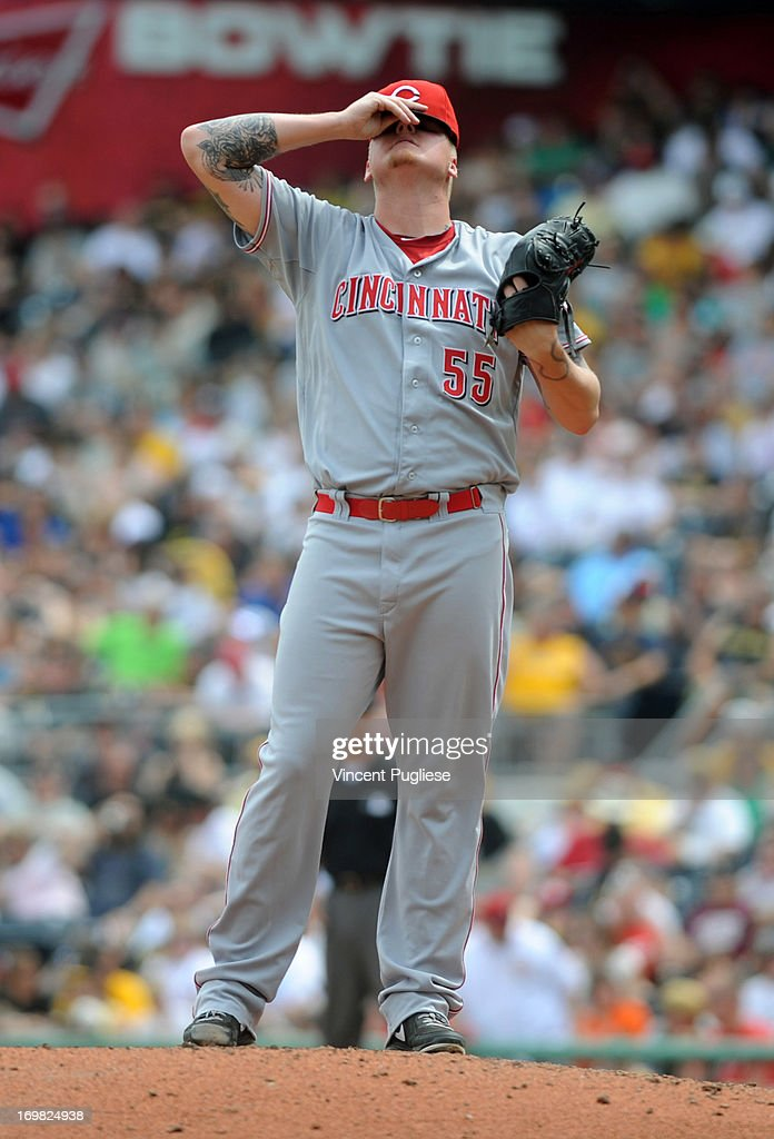 <a gi-track='captionPersonalityLinkClicked' href=/galleries/search?phrase=Mat+Latos&family=editorial&specificpeople=5743563 ng-click='$event.stopPropagation()'>Mat Latos</a> #55 of the Cincinnati Reds takes a break for a moment against the Pittsburgh Pirates at PNC Park on June 2, 2013 in Pittsburgh, Pennsylvania.