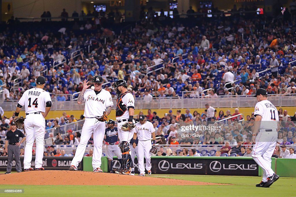 <a gi-track='captionPersonalityLinkClicked' href=/galleries/search?phrase=Mat+Latos&family=editorial&specificpeople=5743563 ng-click='$event.stopPropagation()'>Mat Latos</a> #35 of the Miami Marlins reacts before being pulled from the game by manager <a gi-track='captionPersonalityLinkClicked' href=/galleries/search?phrase=Mike+Redmond&family=editorial&specificpeople=228450 ng-click='$event.stopPropagation()'>Mike Redmond</a> #11 during the first inning of the game against the Atlanta Braves at Marlins Park on April 7, 2015 in Miami, Florida.