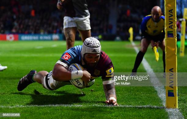 Mat Luamanu of Harlequins dives over to score his side's first try during the Aviva Premiership match between Harlequins and Exeter Chiefs at...