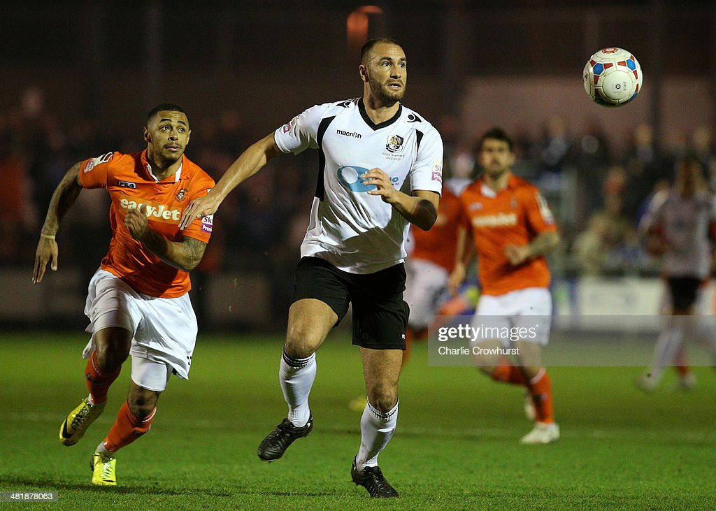 Mat Mitchel-King of Dartford looks to clear his lines during the Skrill Conference Premier match between Dartford and Luton Town at Princes Park on April 01, 2014 in Dartford, England,