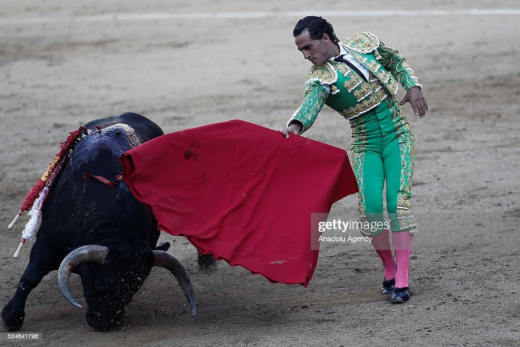 Matador Ivan Fandino performs a pass to a bull during a bullfight, organized with attendance of the matadors Juan Jose Padilla and Jose Garrido at Las Ventas bullring in Madrid, Spain on May 26, 2016.
