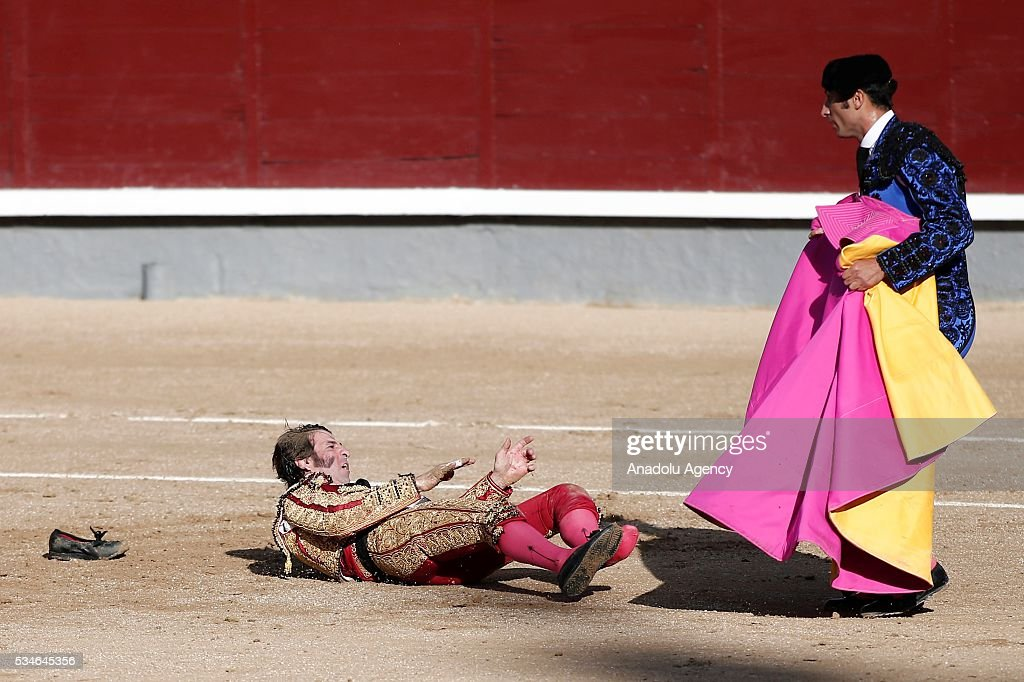 Matador Juan Jose Padilla (L) is injured by a bull during a bullfight, organized with attendance of the matadors Ivan Fandino and Jose Garrido at Las Ventas bullring in Madrid, Spain on May 26, 2016.