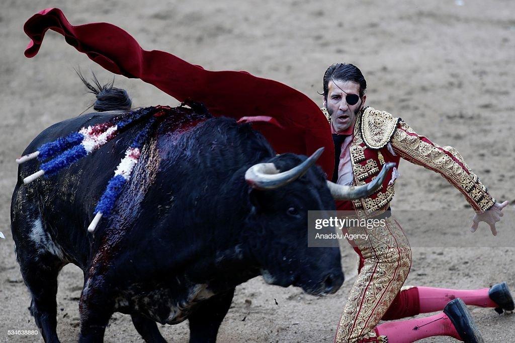 Matador Juan Jose Padilla performs a pass to a bull during a bullfight, organized with attendance of the matadors Ivan Fandino and Jose Garrido at Las Ventas bullring in Madrid, Spain on May 26, 2016.