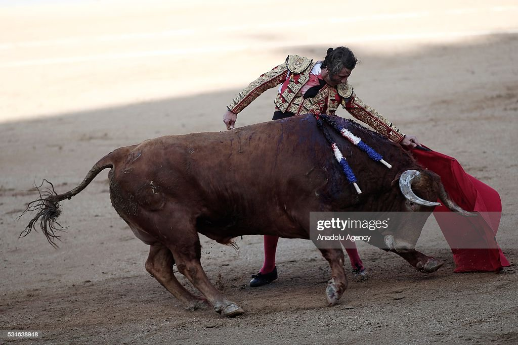 Matador Juan Jose Padilla performs a pass to a bull during a bullfight, organized with attendance of the matadors Ivan Fandino and Jose Garrido at Las Ventas bullring in Madrid, Spain on May 26, 2016.