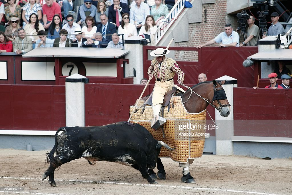 A Matador performs a pass to a bull during a bullfight, organized with attendance of the matadors Ivan Fandino and Jose Garrido at Las Ventas bullring in Madrid, Spain on May 26, 2016.
