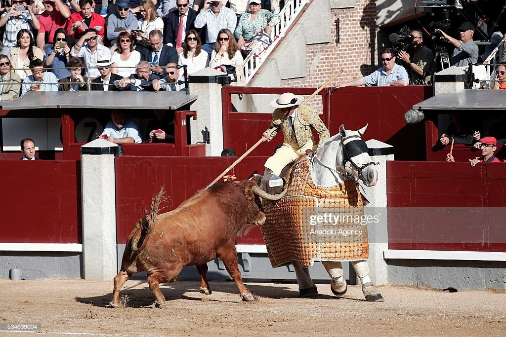 A matador performs a pass to a bull during a bullfight, organized with attendance of the matadors Juan Jose Padilla, Jose Garrido and Ivan Fandino at Las Ventas bullring in Madrid, Spain on May 26, 2016.