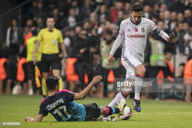Matan Ohayon of Hapoel Beer Sheva Oguzhan Ozyakup of Besiktas JKduring the UEFA Europa League round of 16 match between Besiktas JK and Hapoel Beer...