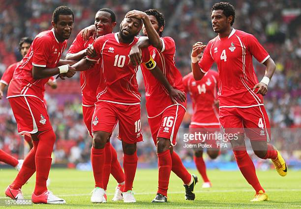 Matar Ismaeil of United Arab Emirate celebrates with his team mates after scoring his team's first goal during the Men's Football first round Group A...