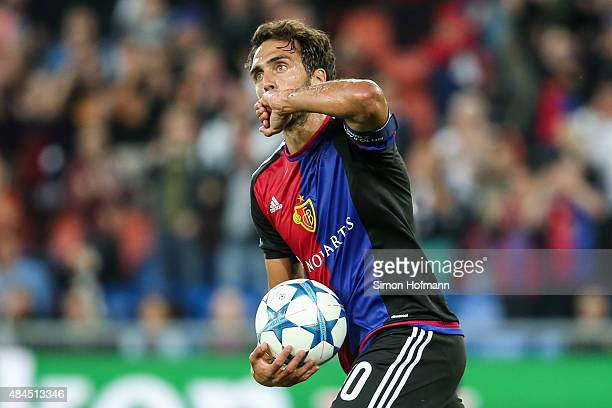 Matas Delgado of Basel celebrates his team's first goal during the UEFA Champions League qualifying round play off first leg match between FC Basel...