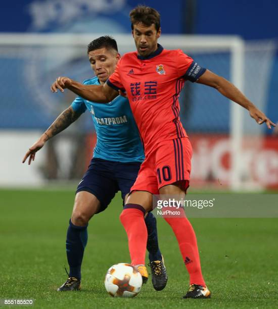 Matías Kranevitter of FC Zenit Saint Petersburg and Xabi Prieto of FC Real Sociedad vie for the ball during the UEFA Europa League Group L football...
