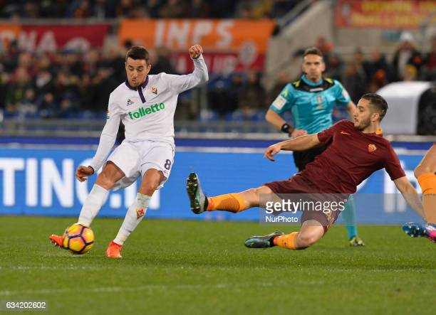 Matías Vecino of Fiorentina vies Manolas of As Roma during the Italian Serie A football match between AS Roma and AC Fiorentina at the Olympic...