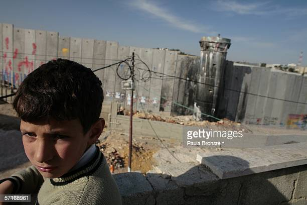 Mataz poses on the balcony of his home inside the Aida refugee camp overlooking the concrete separation barrier March 23 2006 in Bethlehem West Bank...