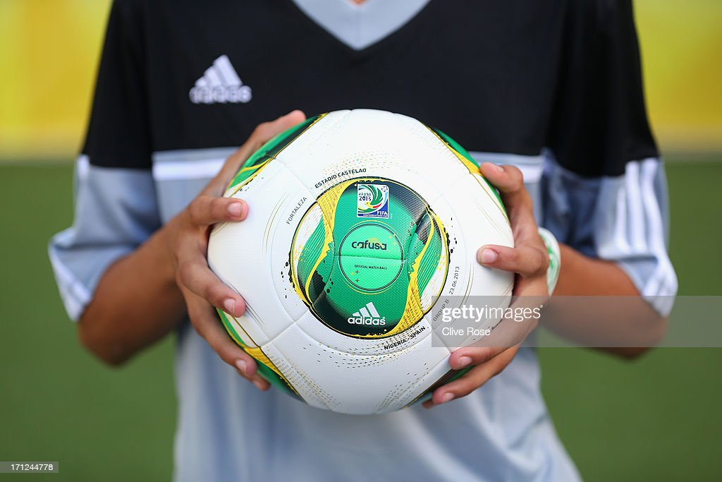 A match ball is held prior to the FIFA Confederations Cup Brazil 2013 Group B match between Nigeria and Spain at Castelao on June 23, 2013 in Fortaleza, Brazil.